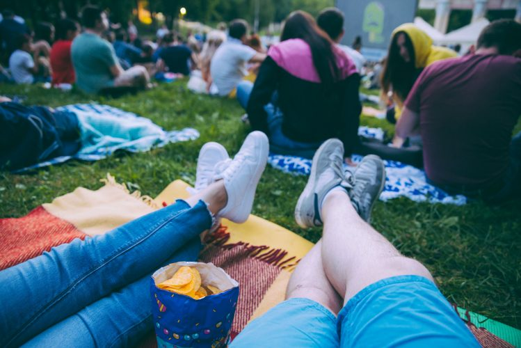 what's on in canary wharf - sitting in a park